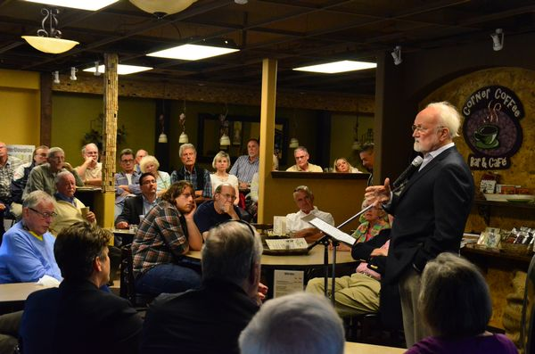 Mayor Dave Earling addresses the crowd gathered at the Corner Coffee Bar and Cafe Thursday night. (Photo by Larry Vogel)