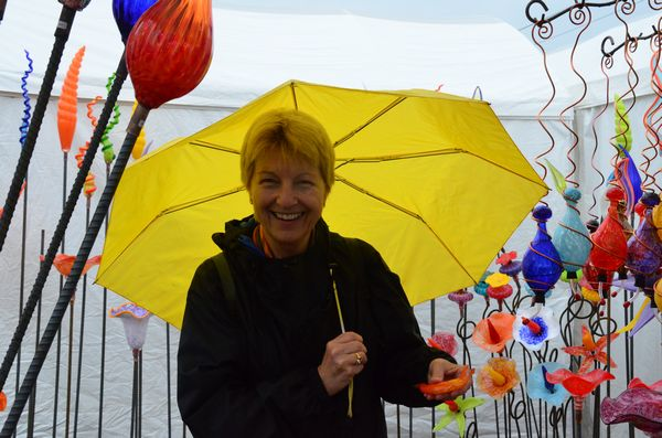 """Bellevue resident Sue Gilbert brings a splash of color with her yellow umbrella. """"I never miss the Edmonds Arts Fair,"""" she said. """"Rain or shine, it's a must-see event for me."""""""