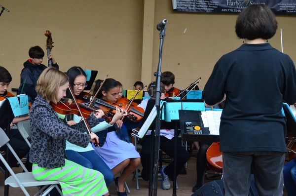 A series of acts on the live music stage offer a chance to sit and take a break from shopping.  Here the Madrona K-8 orchestra under the direction of Vicki Nelson treats the audience to some Telemann.