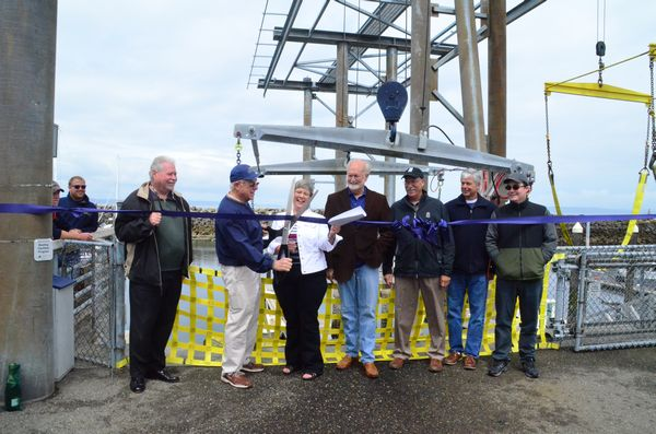 Officials look on as Mike Deller of the State Recreation and Conservation Funding Board (CFB) cuts the ribbon. The CFB funds grants to worthy projects throughout the state, and was instrumental in providing 75% of the funding for the Edmonds Boat Launch projects. CFB funds come primarily from taxes levied on sale of marine fuels. L to R: Fred Gouge, Port Commissioner; Mike Deller; Port Deputy Director Marla Kempf; Edmonds Mayor Dave Earling; Jim Orvis, Port of Edmonds Commission President; Bob McChesney, Port Executive Director; Chris Osterman, Port Employee.