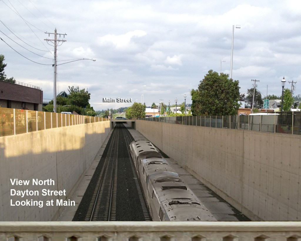 """Katharine Gold, who along with her husband Charles is supporting the idea of a train trench, asked us to substitute this photograph of the concept. """"I have reworked the conceptual photograph to make the train and the trench more accurate in scale, as it would be seen standing on Dayton Street looking north to Main Street,"""" Golden said. """"The original image makes the trench look much deeper than it would actually be (24.5 ft). """""""