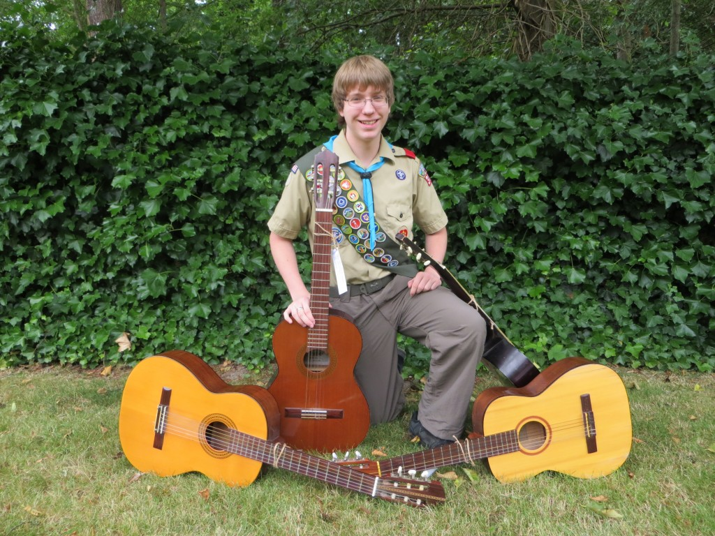 Nathan Battern with guitars he's collected so far for his Eagle Scout project.