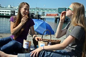 Emma and Keturah enjoy a Rain City Crunch snack on  a sunny Edmonds day.