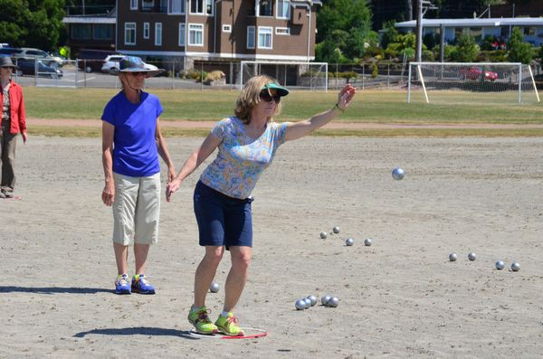 Contestants line up their shots and let the ball (called a boule') fly.