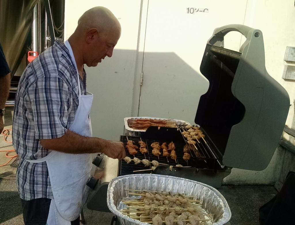 Simon Majumdar works the grill at American Brewing Friday night.