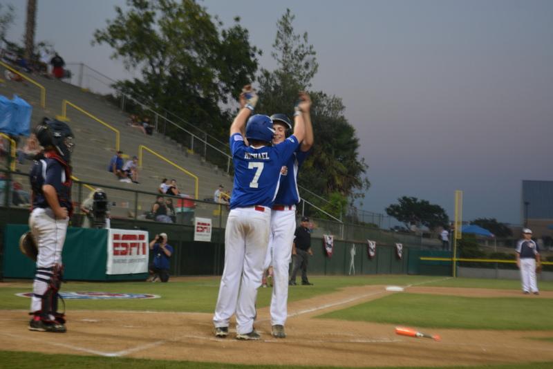 Pacific Little League's Ian Michael congratulates Karsten Tjarneberg after his 2-run home run in the sixth inning against Montana.