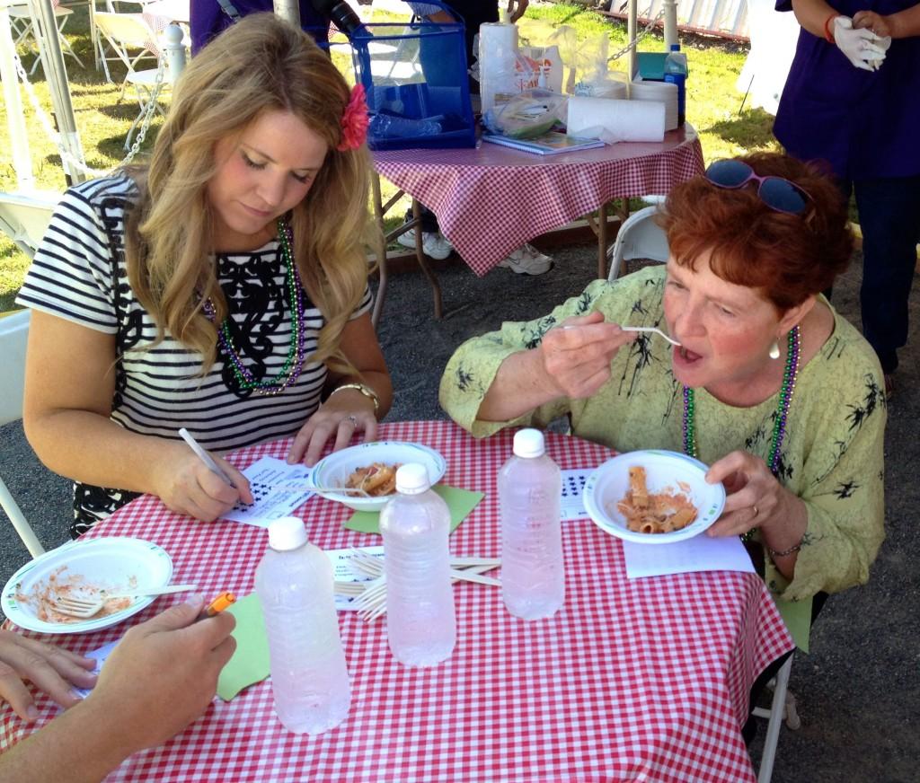 Tasteoff judges Courtney Generaus from ServPro and Kathy Passage, My Edmonds Restaurant News columnist, taste the Rigatoni Bolognese.