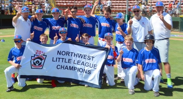 Players and coaches display the Northwest Regional Championship banner.