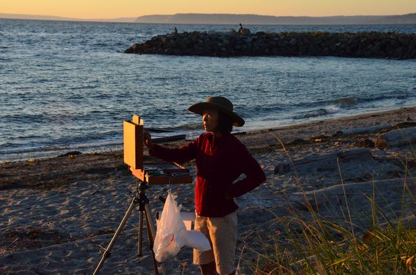 Plein Air artist Connie Nelson  captures the Monday evening sunset at Edmonds' Brackett's Landing.  Nelson is one of several artists whose work will be featured in this month's Beauty of the Northwest show at Edmonds' Gallery North .