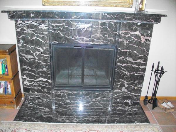 Breccia de Notre Dame marble slab fireplace.
