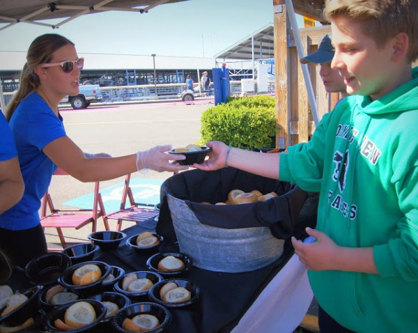 Jocelyn Clelland from Anthony's Homeport hands out free mini chowder bowls.
