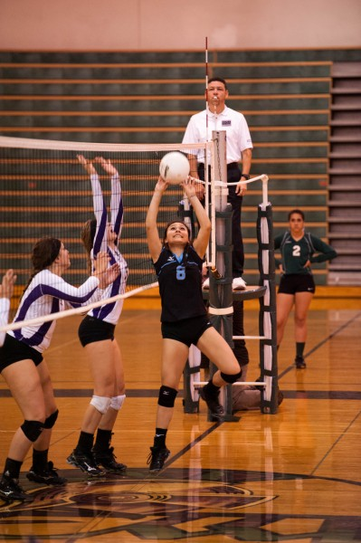One of Mariel Gonzales' team-leading 9 assists for Meadowdale.