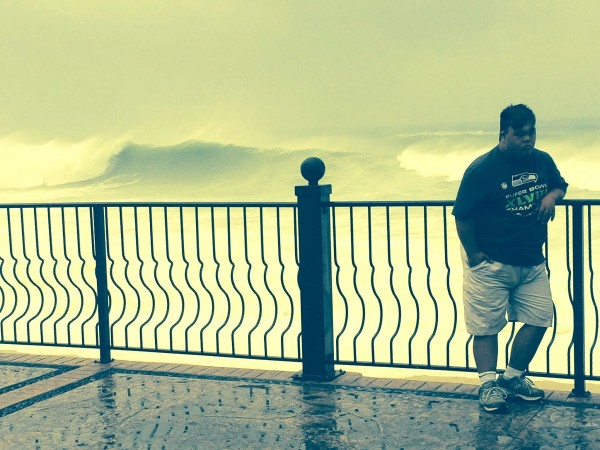 Dominick Monillas stands by the beach before the hurricane struck.