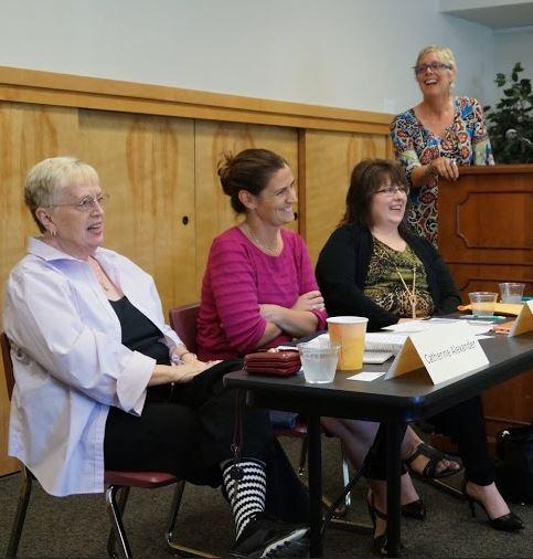 Catherine Alexander, Sarah Kishpaugh, Roberta Trahan, and Mary Heffernan share a laugh at Edmonds Conference Center.