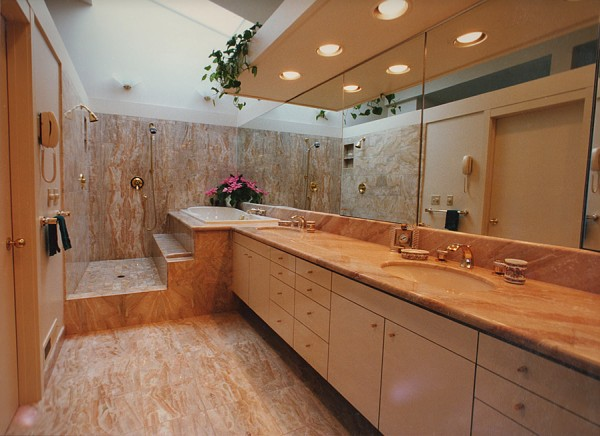 Breccia Oneceata marble tiles and slab that are book matched and vein matched.
