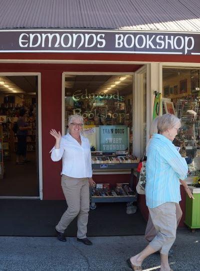 Mary Kay Sneeringer welcomes visitors to Edmonds Bookshop.