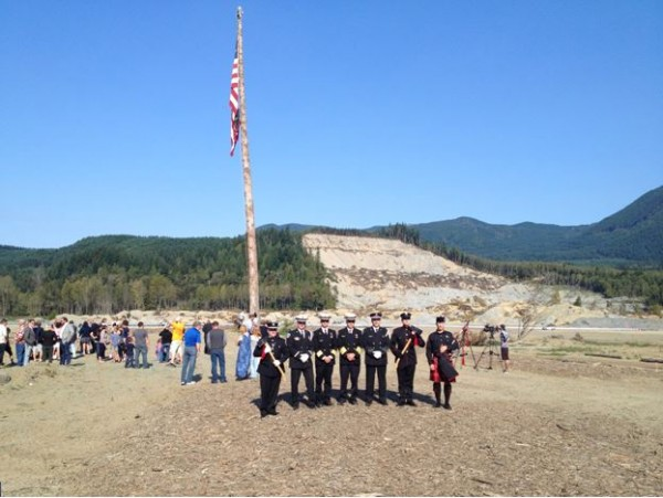 Oso memorial from the left - 4th, Chief Willie Harper, Oso; 5th, Chief Steve Mason, Edmonds. Photo by Bob Mitchell.