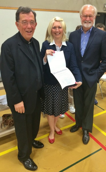 Edmonds Mayor Dave Earling visited Holy Rosary Catholic School in downtown Edmonds Friday to issue a proclamation honoring the 50th anniversary since the school's founding. Pictured with Earling are