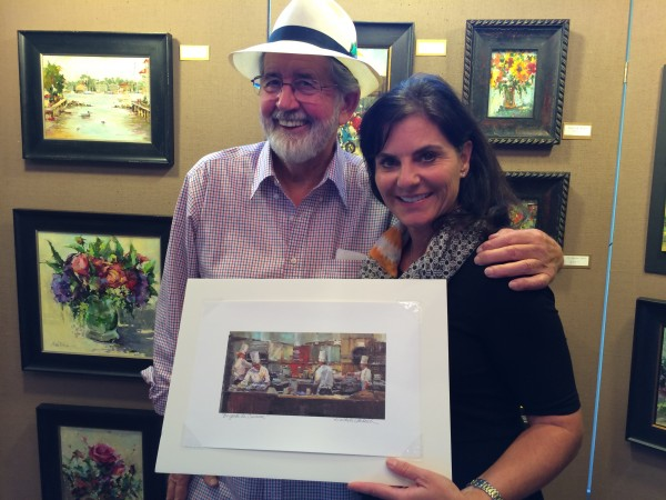 """Carol Kinney sent this photo along of Doug Lofstrom, who bought a print from Michele Usibelli during this weekend's Edmonds Art Studio Tour. """"We hope 'Brigade de Cuisine' will inspire us to cook, said Kinney. Loftstrom and Kinney produce cooking videos under the  name Konkydoodle Kitchens."""
