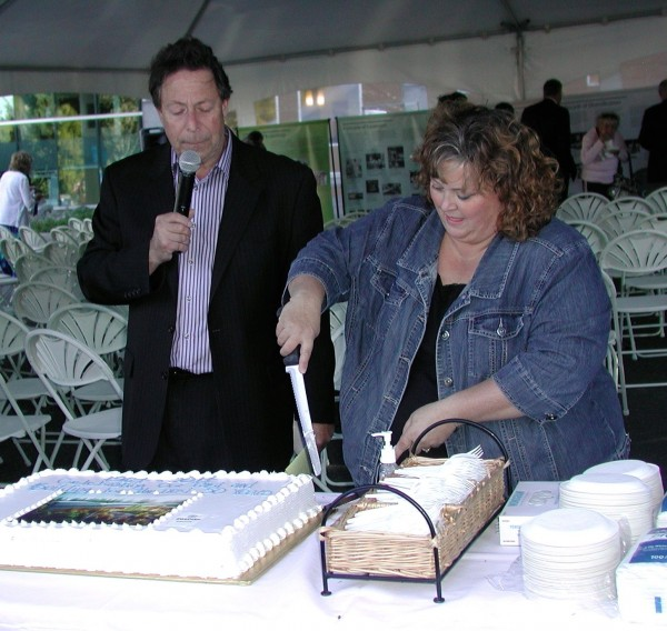 Jaffe watches as long-time Bobbi Nyland cuts the anniversary cake.
