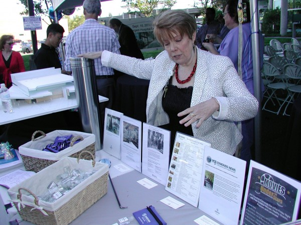 Karen Thompson, Swedish Edmonds physician relations coordinator, explains the items that will be included in a time capsule. (Note the My Edmonds News articles!)