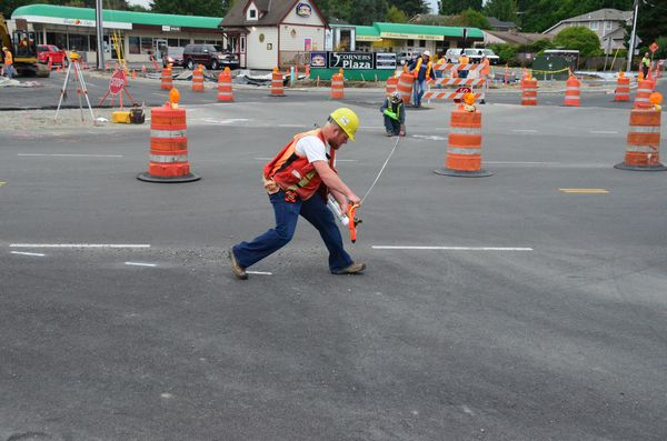 Marking out the area where pavement will be removed to create the new roundabout center island.