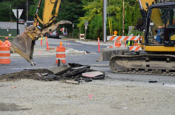 The old pavement is broken up to create the new center island.