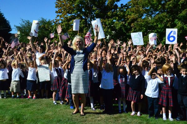 Principal Sue Venable joined the students to close the ceremony with the traditional hands-held-high cheer.