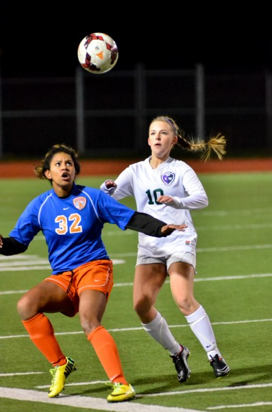 E-W's Jaclyn Metz (10)  and Auburn Mountainview's Josette Lake keep their eye on the ball. (Photos by Karl Swenson)