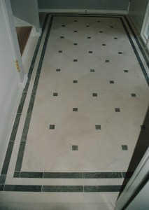 A closeup of the entry way. Claire Limestone tiles with St. Thomas Lila Marble borders and 2-inch dots on corners of limestone.