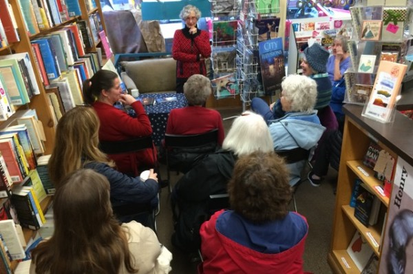 "Edmonds author Judith Works speaks to a large gathering at the Edmonds Bookshop Saturday. Works did a reading of her newly released novel, ""City of Illusions."" You can read more in Emily Hill's Artfully Edmonds interview with Works here."