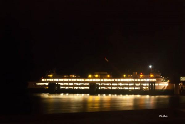 The Edmonds-Kingston ferry lights up the Tuesday night sky. (Photo by Ken Sjodin)