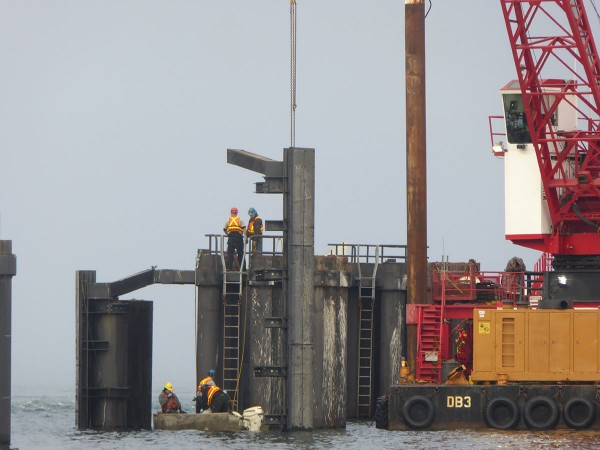 Gayle Ketzel took this photo Tuesday morning as workers were repairing and replacing parts of the pilings at the Edmonds ferry dock.