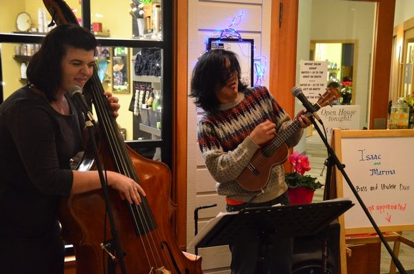Thursday night's Mosaic Salon Group open house featured live music by Isaac Castillo and Marina Christopher, and bass and ukulele duo.