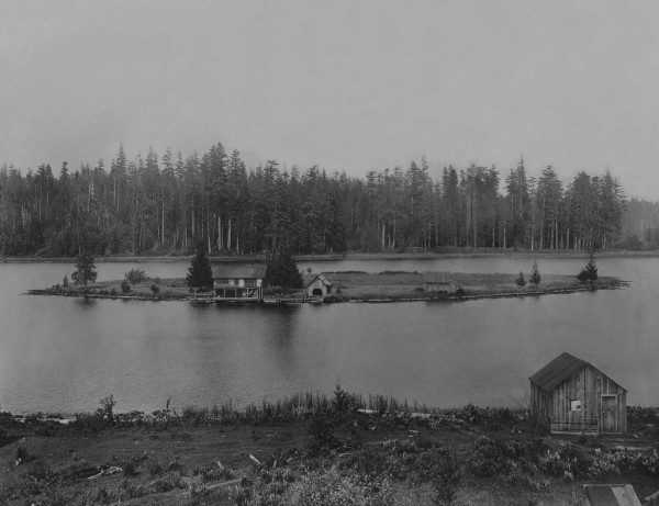 """Julia and Richard Ballinger owned a """"gas-powered"""" rowboat to reach their summer home on their namesake Lake Ballinger. This 1911 view looks east from near the tracks of the Seattle-Everett Interurban. (Courtesy, Ron Edge via PaulDorpat.com)"""