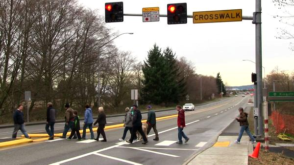 Pedestrians try out the newly-opened crosswalk across State Route 104 connecting City Park and downtown Edmonds to Harbor Square, the Edmonds Marsh and the Point Edwards neighborhood.