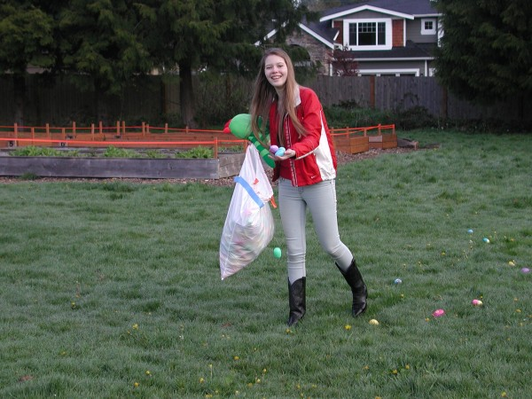 A volunteer spreads eggs on the field prior to the egg hunt at Edmonds Lutheran Church, in the Highway 99 neighborhood.