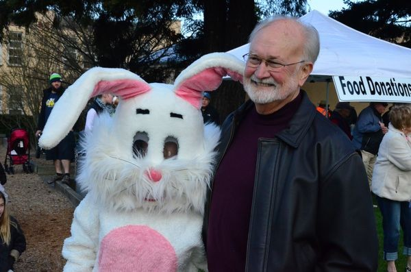 The Easter Bunny finds Edmonds Mayor Dave Earling for a photo op at the Rotary Egg Hunt. (Photo by Larry Vogel)
