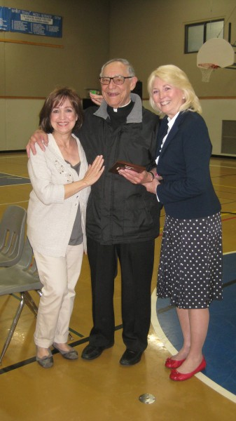 From left, Karen Petosa, Father Joe Petosa and Holy Rosary Principal Sue Venable post for a photo Friday. (Photo courtesy Holy Rosary School)