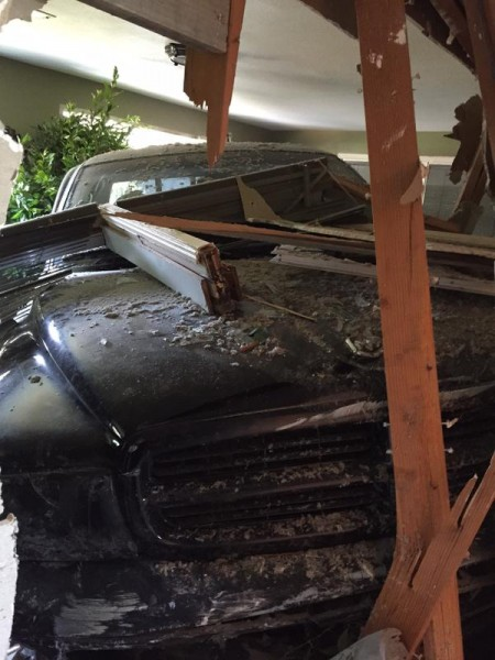 The aftermath of Friday morning's truck-into-house crash. (Photos courtesy Edmonds PD)