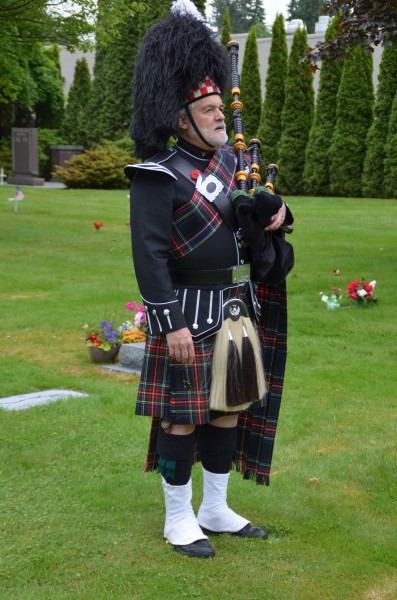 "Bagpiper Mike Barber played ""Amazing Grace."""