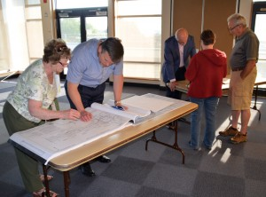 City staff discuss plans with residents living near the project.