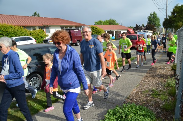 Walkers and runners get moving at the start line.