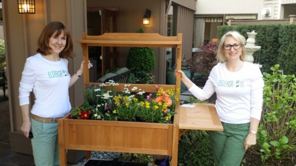 From left, Eldergrow founder Orla Concannon with COO Amy Gregory. The floral garden shown was designed by residents during the Earth Day activity. The garden is mobile so that it can be moved around the community for all to enjoy.