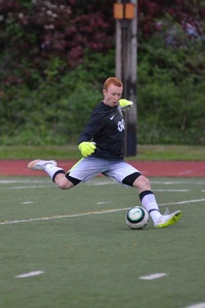 EWHS goalie Griffin Small kicks the ball away Saturday. {Photos by Karl Swenson
