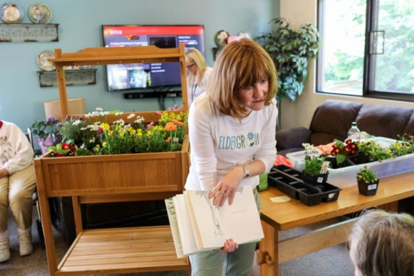 """After the garden was designed, Orla read one of her favorite books, """"The Giving Tree,"""" by Shell Silverstein, to residents. Eldergrow's mission is to enrich and engage the residents through activities in conjunction with the gardening products."""