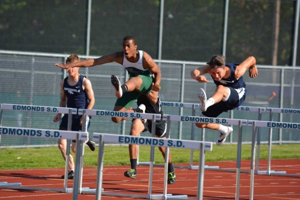 From left, Aaron Richardson (E-W 2nd place) and Harry White (Meadowdale 1st place) in the 110 meter hurdles.