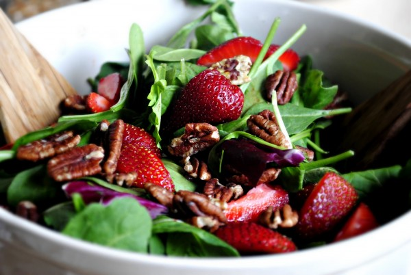 Combine strawberries and baby greens in a refreshing salad.