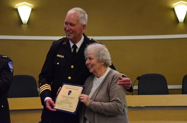"Chief Compann presents Betty Evans ""Lady Elizabeth"" with her Citizen Service Citation recognizing her many years of volunteer service to the Department."