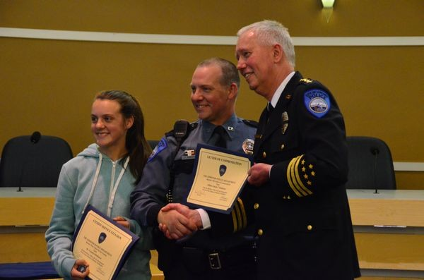 The father-daughter team of Officer Jason Robinson and Camdyn Robinson accept their awards in recognition of their joint project to provide assistance to the less fortunate members of our community.